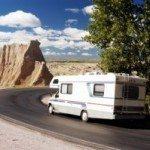 RV Turning Down Desert Road