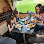 Family Eating Their Meal In The RV