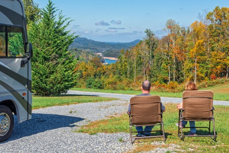 Couple Sitting Outside of RV