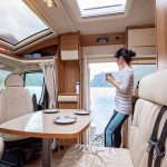 Woman standing in remodeled RV