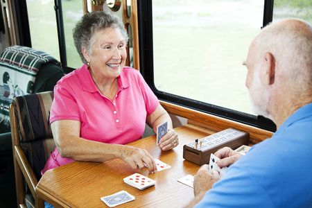 Man and Woman playing card games on Rv road trip